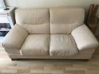 Cream Leather 2 Seater Sofa with mahogany coloured wooden feet