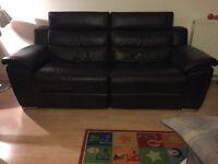 One Black Leather Reclining Sofa