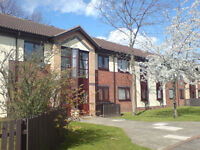 2 Bedroom, Modern ground floor flat, Unfurnished, with parking and patio area.