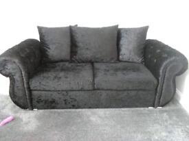 Black velvet sofa & cuddle chair