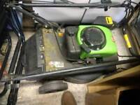 Power performance petrol lawnmower with powered drive