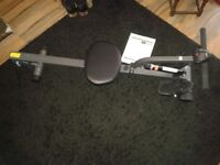 Rowing machine with calorie counter, time, rows and intructions. Great for beginners,