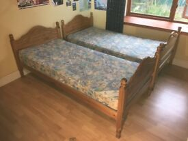 "Twin beds with mattresses. Antique Pine 6'4"" length"