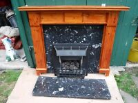 Living flame gas fire, marble backing and hearth, and a wooden surround