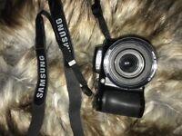 Samsung WB100 digital camera.