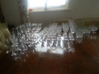 Assortment of crystal and plain glasses