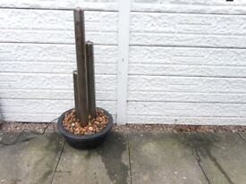 stainless steel tubes water feature.