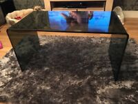 Solid smoked glass coffee table