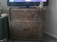TV unit in brown veneer ,pull down storage and cupboards to stack CD or dvd