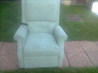 Electric Rise And Recline Comfy Chair in Light Green Pattern Material.
