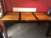 Large used dining room table with 4 brown chairs
