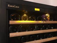 EUROCAVE wine fridge/cabinet : holds over 200 bottles. 3 sliding racks, 2 storage shelves. Adj temp.