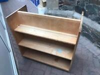 Double sided book case on wheels