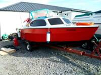 Fishing boat .outboard and trailer