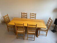 1979 Ercol pine refectory table and 6 pine ladderback chairs with original cushions.