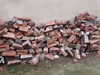 Free bricks from a wall. Free to anyone that can collect them