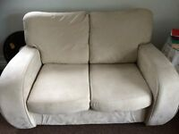 Stylish and elegant cream suede 2 seater sofa in immaculate condition.