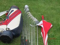 Complete set of golf clubs, bag and trolley