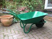 Green wheelbarrow in very good condition
