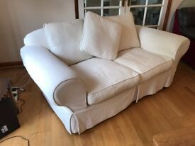 Cream fabric two seater sofa