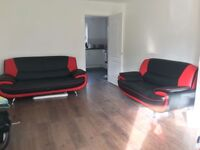 Black and Red Leather Sofas 3 Seater + 2 Seater