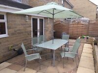 Glass garden furniture set - table, extension table, chairs and parasol included