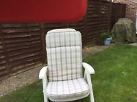 White garden lounge seat with cushions