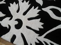Brand new, unused black and ivory rug