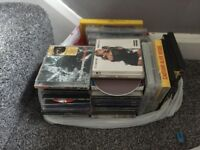 Around 50 cds and 10 dvds