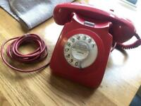 Old vintage red BT dial up telephone 1974