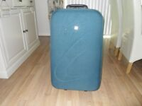 Green Medium Sized Suitcase in very good condition