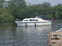 Elysian 27 diesel shaft drive river cruiser, boat
