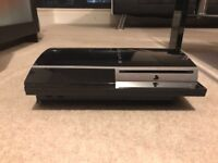 PS3 with controller and all leads. Comes with 4 games