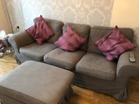 Grey 3 seater sofa with armchair and footstool including pillows
