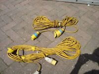 2 x 110 VOLT EXTENSION CABLES WITH PLUBS. OVER 50 FT LONG. WILL SEPARATE