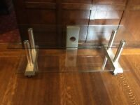Oblong glass television stand on castors