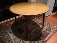 Dining Room Table good condition. Round 107cm diameter, extending to 137 x 107cm. Medium wood colour