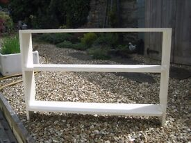 Old painted wooden shelf unit in cream. Handy shelves.