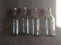 4 glass water bottles