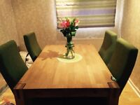 Solid wood dinning table & 4 chairs. 3 years old, immaculate condition