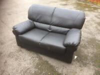 2 seater black leather sofa free delivery in ten miles