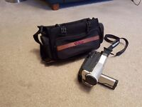 8mm camcorder with connections and case.