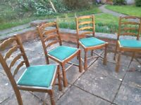 4 Hardwood dining chairs with Derwent forest green upholstery.