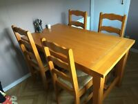 Wooden dinning table with 4 chairs