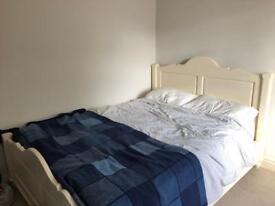 Cream wooden bed