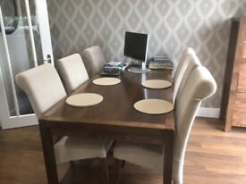 Extendable dinning table and six chairs