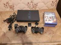 Sony PS2 black Console + 2x controllers & 5 games