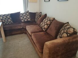 Brown corner sofa with throw cushions