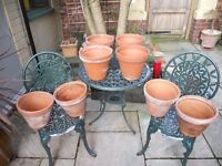 8 Convenient and Matching Terracotta Plant Pots.