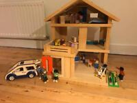 Pintoy 3 storey wooden dolls house with 9 dolls and car